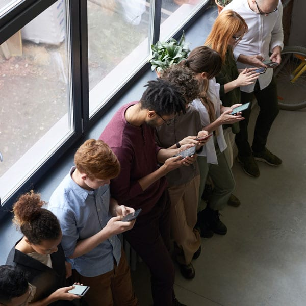 line of people checking their social media management reputation
