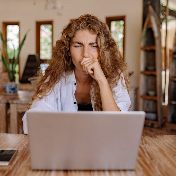 woman on computer upset by someone's comments on social media