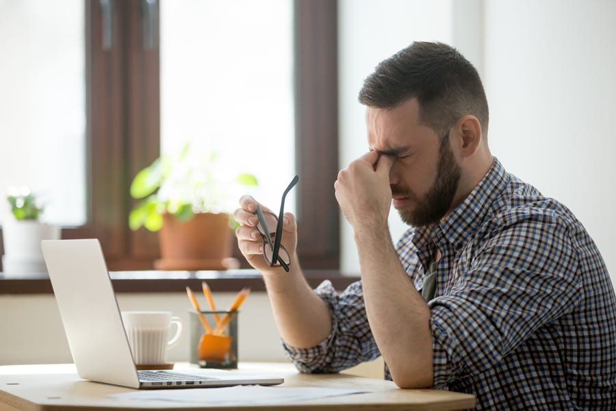 man suffering from stress at work