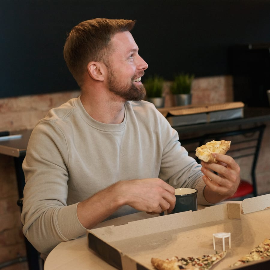 man coping with stress at work by taking lunch break