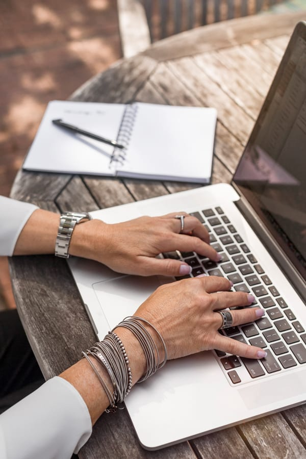 woman's hands typing and creating SEO plan on laptop