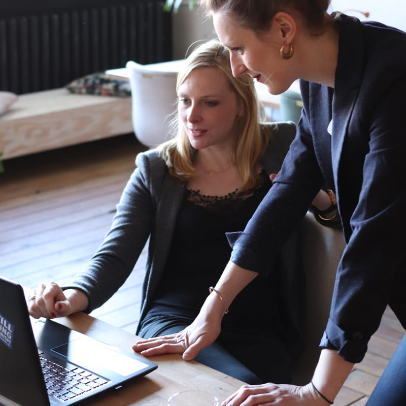 woman choosing coworker as one of job references and showing her resume