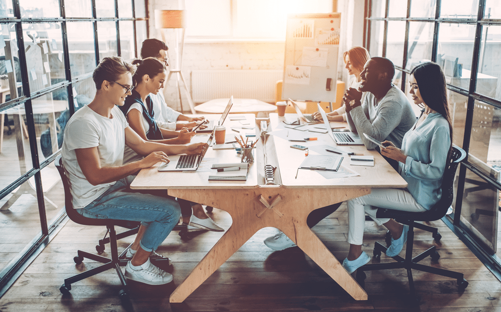 group of recruiters sitting at table wondering if ai will replace recruiters