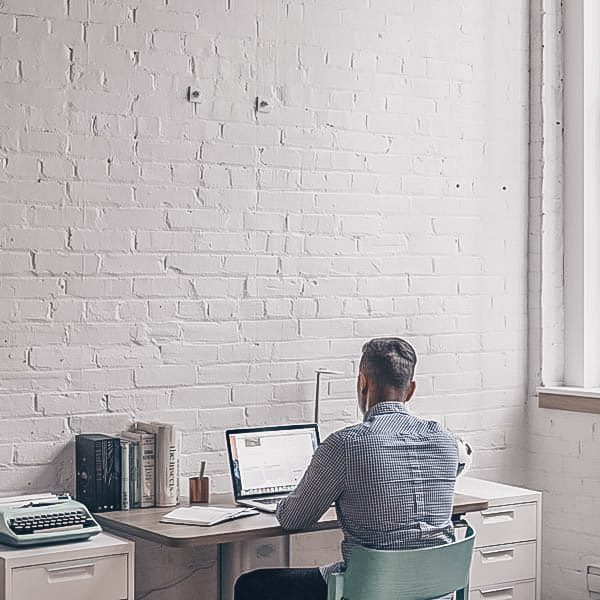 man coding working from home in industrial apartment