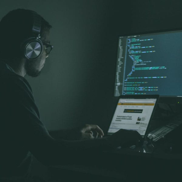 man with cybersecurity skills working on code to prevent attack