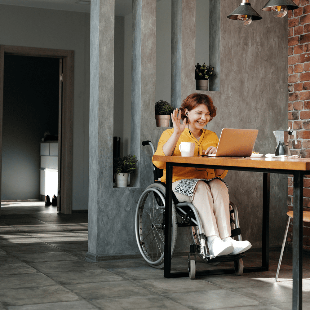 woman sitting in wheelchair attending virtual networking event