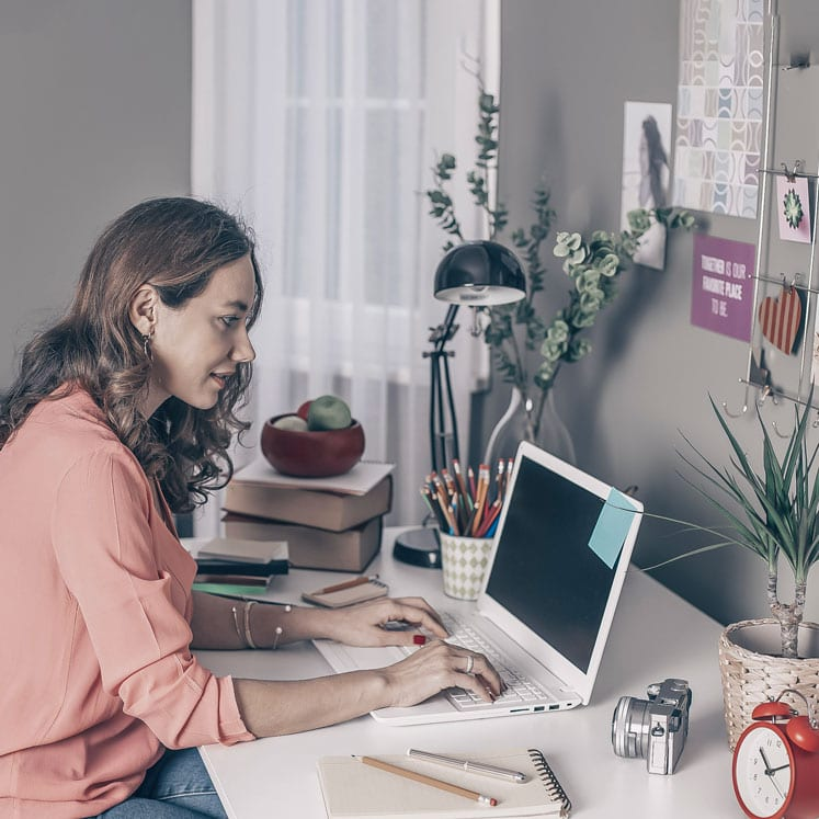 woman establishing working from home productivity tips at desk