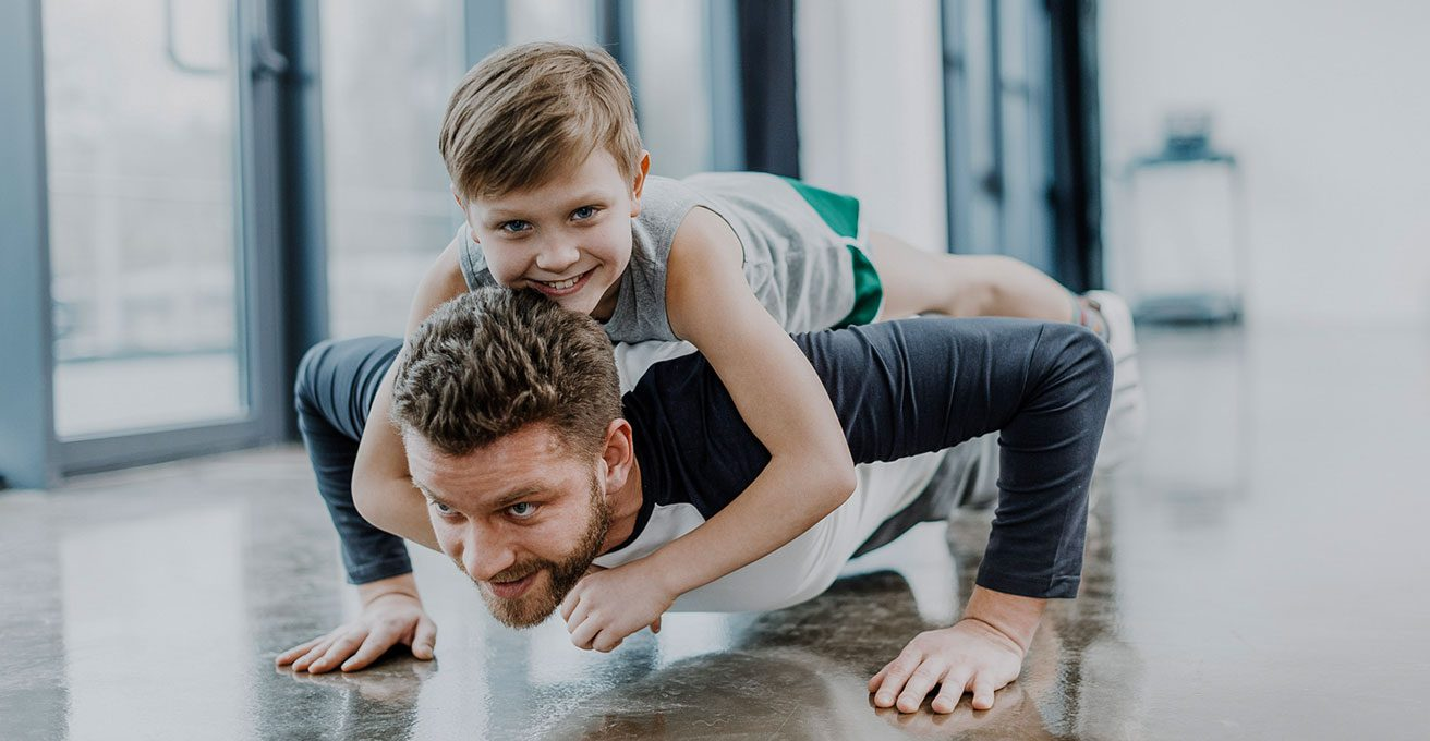 man at westchase chiropractic exercising with son