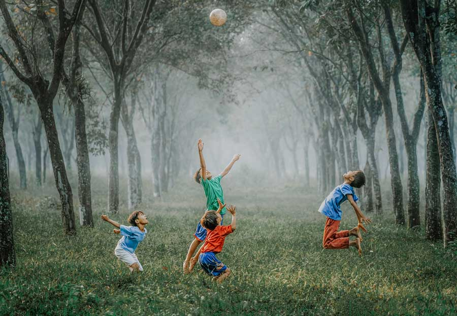 healthy diet plan for kids leading to children playing outside in nature