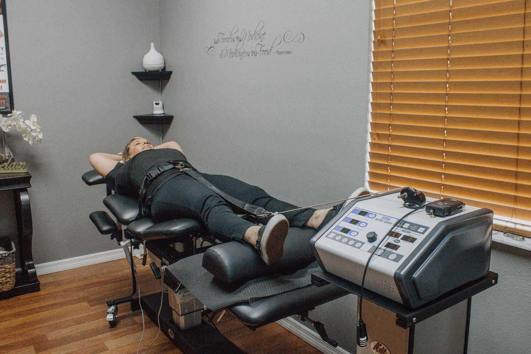 female patient undergoing spinal decompression therapy at westchase chiropractic
